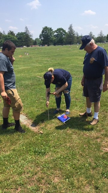 East Franklin Members Place Flags on The Departed Members Grave Sites